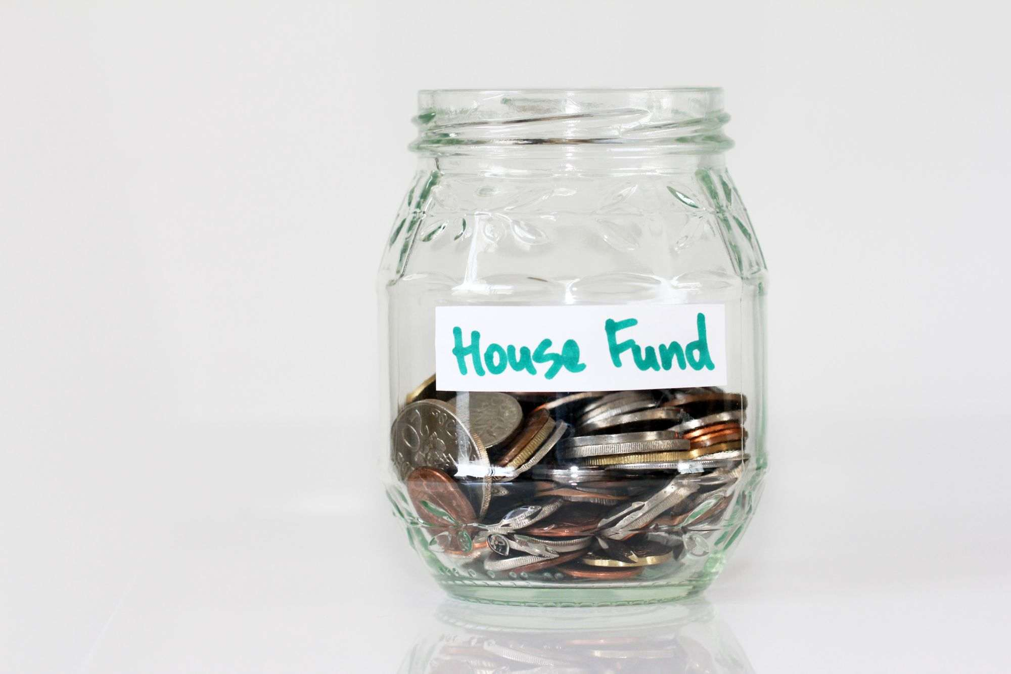 Glass-Money-Jar-with-Loose-Change-Inside-and-House-Fund-Label