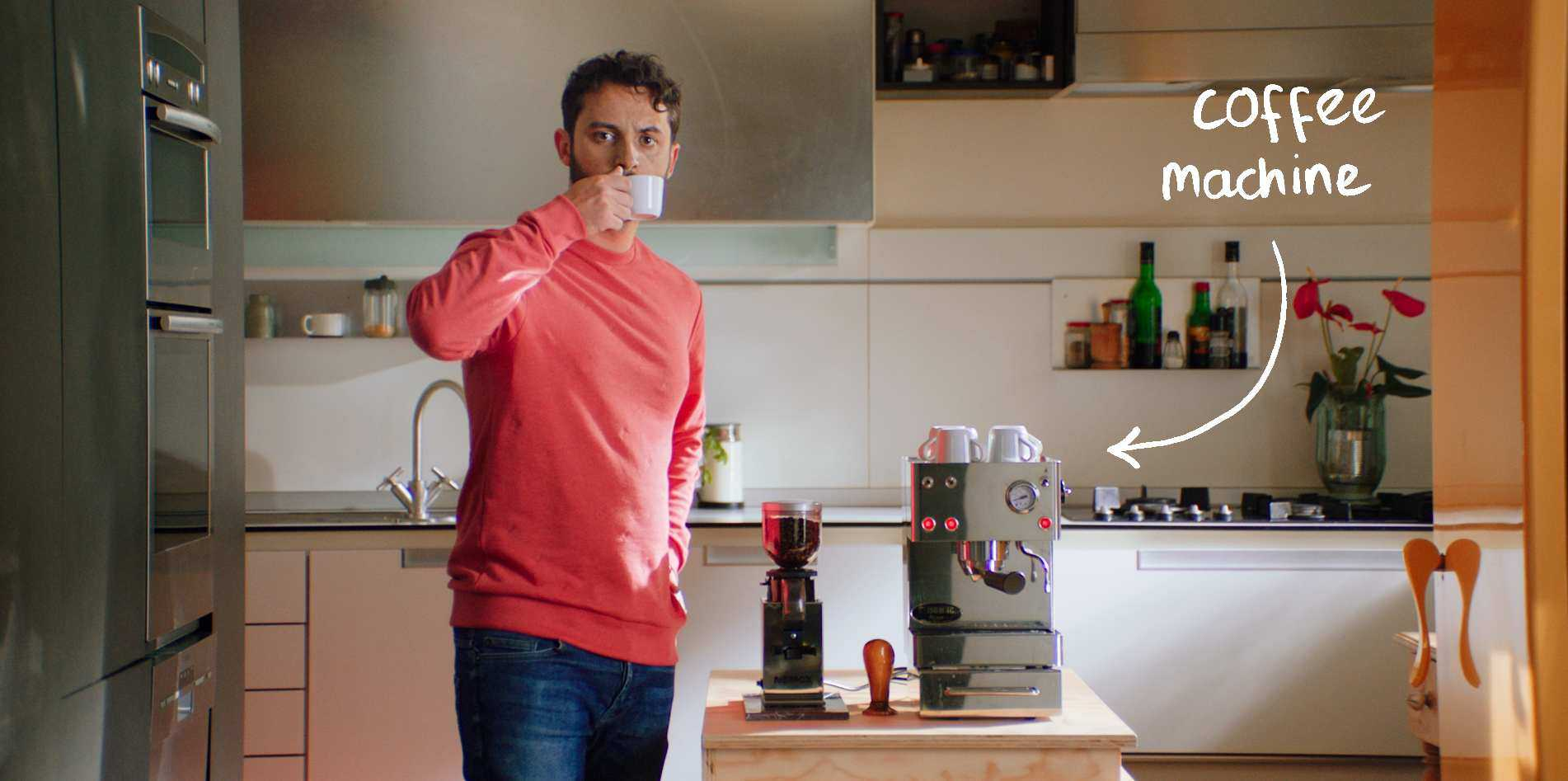 Male-Renter-Drinking-Coffee-from-His-Coffee-Machine