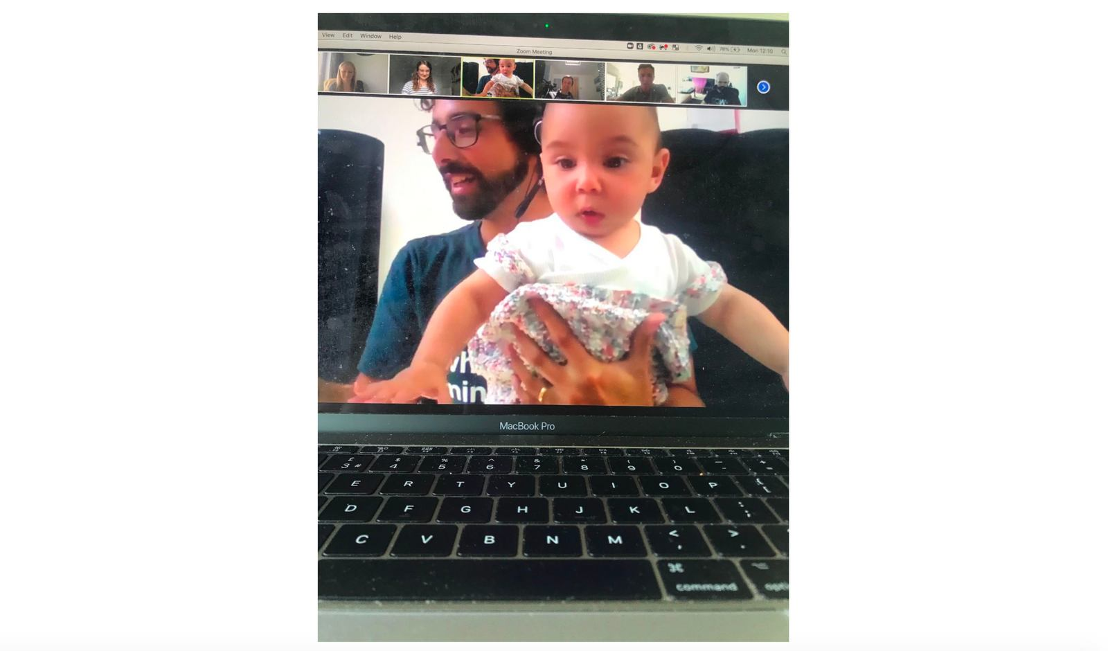 Adam with his son on a Zoom call drawing teams for upcoming charity fundraiser